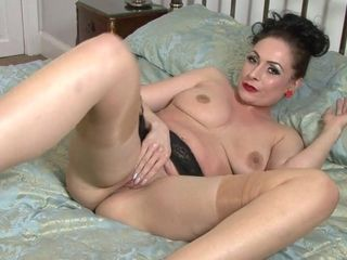 Cougar doll is unclothing on the sofa