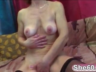 Horny granny Ivet plays with tits while getting fucked raw on sofa