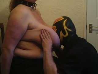 Nasty mature uncle in a mask sucking and kneading his wife's huge boobs