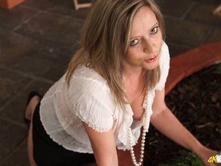 Mature female Lou Pierce demonstrates off her supah succulent large funbags