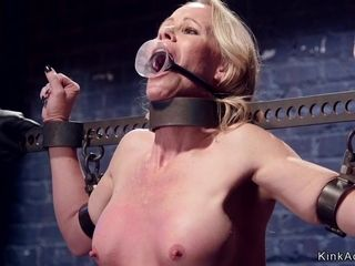 Housewife ball-gagged in iron stock caned