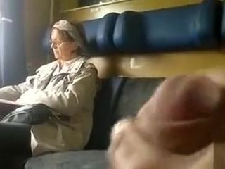 Jerking my dick next to a mature lady
