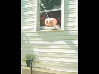 Super-naughty fake penis ejaculation spraying out of window while neighbors are outside!