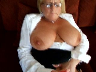 Fabulous mature blonde woman with big jugs masturbates on the couch