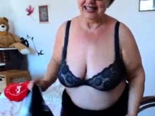 Granny playing with  big boobs on webcam! Amateur!