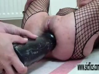 Large dual faux-cock smashing each of her demolished fuck holes