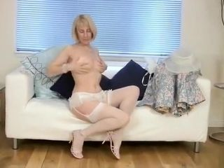 Mature housewife smashes a cucumber