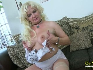 Super-steamy curly blond mature tramp is glad to have fun with her humungous bra-stuffers