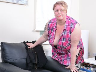 Mischievous mature plus-size playing with herself