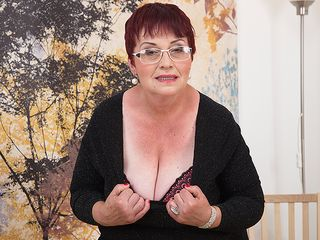 Nasty grandma plays with her melons and fur covered vag