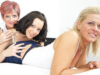 Three elderly and young lesbians making out on the bed