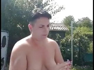 Mature naturist flashes her pierced coochie