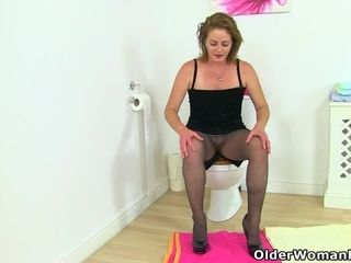 Brit cougar marvelous Jozie undresses and plays on rest room
