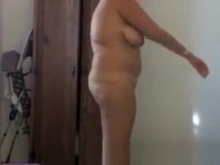 Mature wife dressing in bedroom