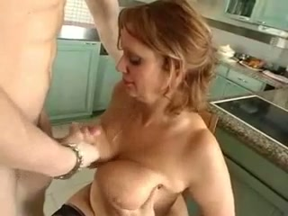 This mature woman is ripe as hell and she is need of a young man's dick