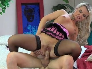 Housewife light-haired with harness and pantyhose rails masculine stick